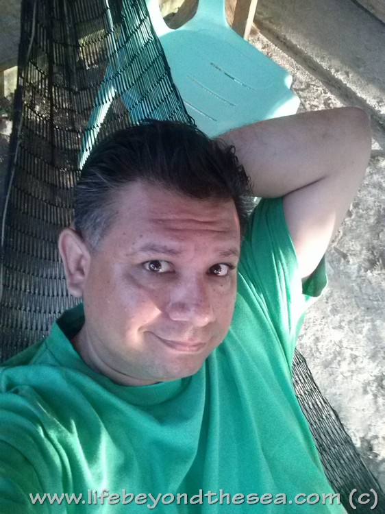 Me in the fish-net hammock on my front patio.